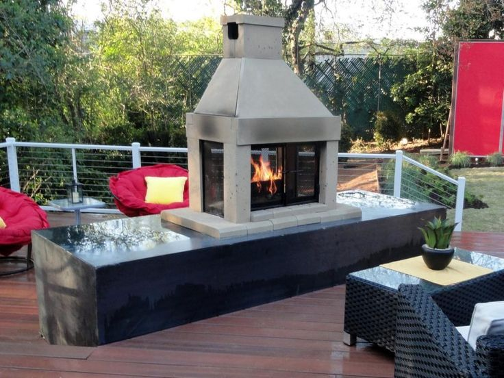 Furniture Propane Outdoor Gas Fireplace Above Laminate Wood Flooring With White Stainless Steel Fences Have Black Wicker Chair And Wicker Table Used Glass Top Modern Outdoor Gas Fireplace