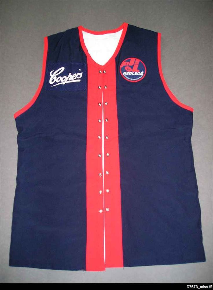 Replica Norwood guernsey worn by Danny Morton in 2001 to mark the 100th anniversary of the first game played on Norwood Oval, also known as The Parade. Of course the original worn in 1901 did not have the logos of the club and sponsor