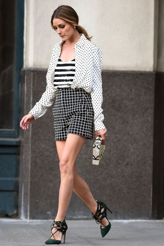 Olivia Palermo wears a sparkly striped shirt paired with other black and white patterns: