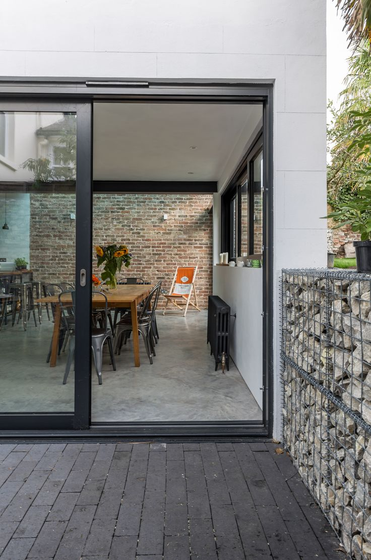 Large sliding glass doors | modern architecture | industrial aesthetic |  level threshold | dining room