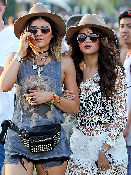 HATS OFF After a recent night of clubbing, Kylie Jenner and Selena Gomez keep the party going as they navigate the Coachella Music Festival on Friday in Indio, Calif.