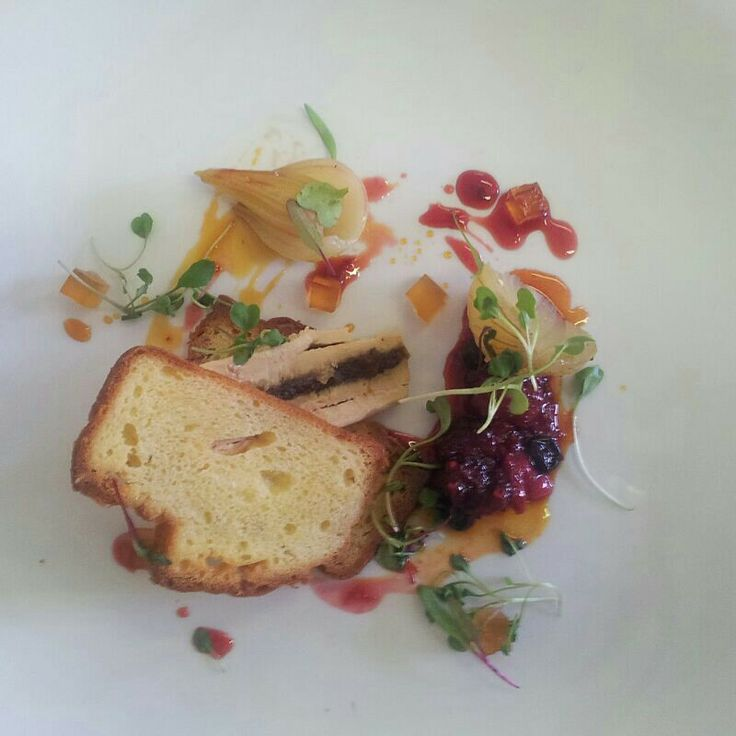 Date and foie gras parfait on a brioche sandwich with verjuice gastrique, pickled onion and black pepper & berry compote.