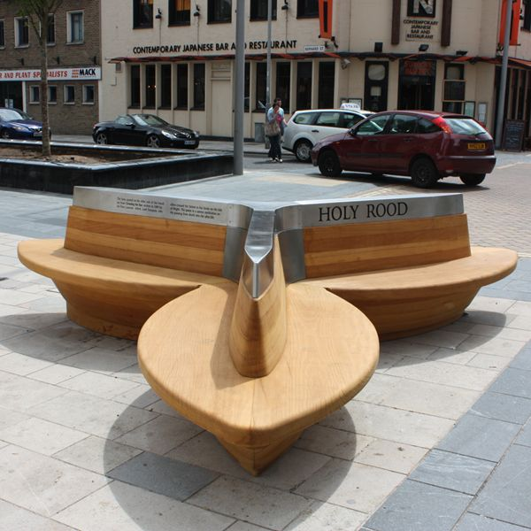 Woodscape, Bespoke, Hardwood, Innovative, Hardwood, Timber, Street Furniture, Outdoor Furniture, Urban Realm, Public Spaces, Seats, Seating, Benches, Seating, Seating, Benches, Southampton, Trefoil, Church, Public bench, Engraved, Holy Rood,