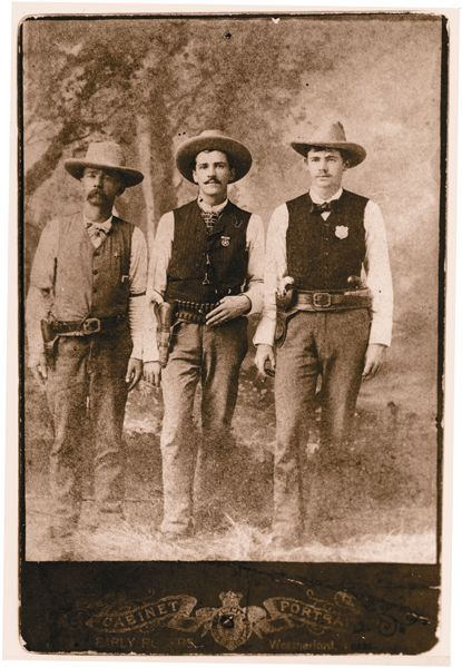 Deputy U.S. Marshal Edward W. Johnson, left, lost his right arm soon after this photograph was taken. He's standing beside Texas Ranger Lorenzo K. Creekman and Parker County Deputy Sheriff E.A. Hutchison. – Courtesy George T. Jackson, Jr. –