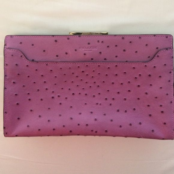 Authentic Coach Clutch Purple ostrich leather clutch. Card slot inside, one external pocket. Small pen mark inside and small scratch on gold clasp Coach Bags