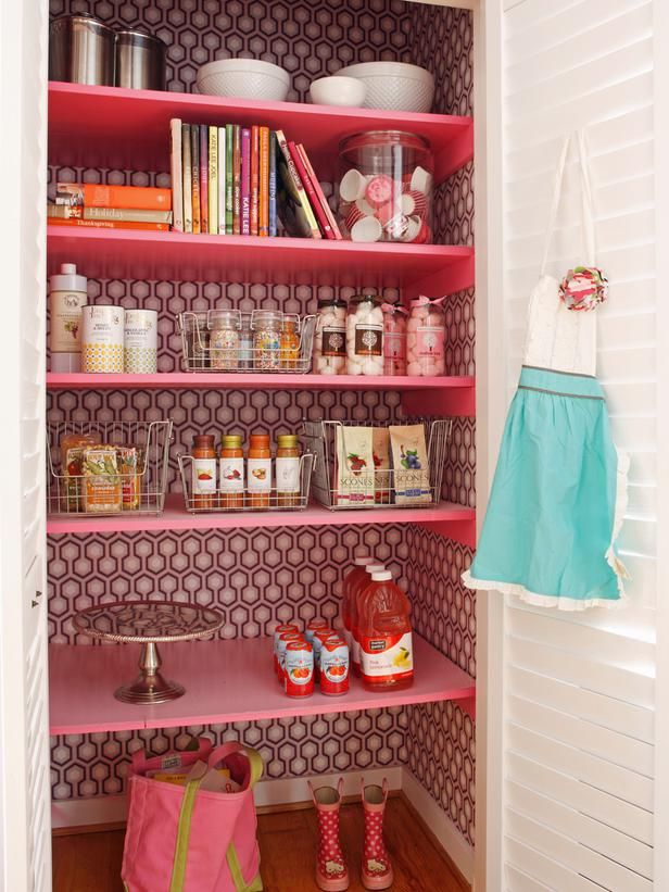 A Modern, Coastal Kitchen Remodel (On a Budget): The pantry gets its fair share of use whether Melissa is baking for family and friends or Natalie is reaching in several times a day for a healthy snack. To add energy, color and an element of surprise, the hexagonal wallpaper was installed along the pantry interior, and the shelves were painted high-gloss pink. From DIYnetwork.com