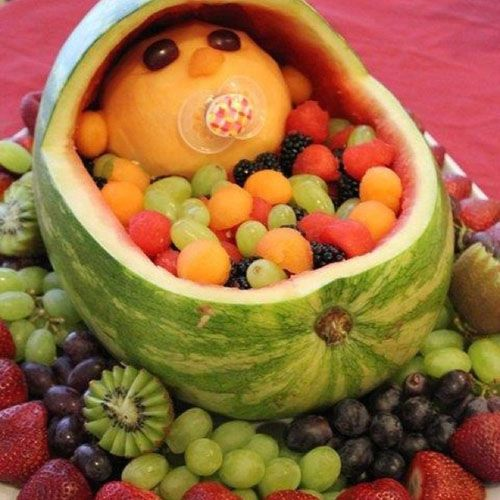 Watermelon centerpiece for baby shower.. use fruit to create baby and carriage.. finish off with pacifier.. adorable!