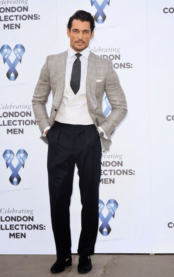 British model and style icon David Gandi looking sharp in this grey checked blazer white waistcoat and navy trousers    www.memysuitandtie.com