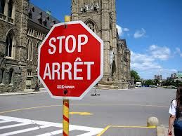 Language: a stop sign showing the two official languages of Canada: 1969-present