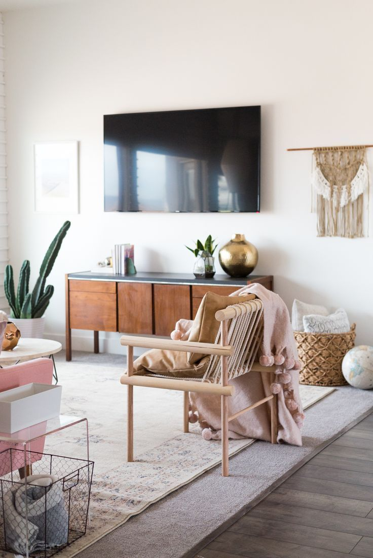 I can't believe that most of this room was either thrifted or DIYed! So many cool details and such great eclectic, boho living room inspiration! | Vintage Revivals