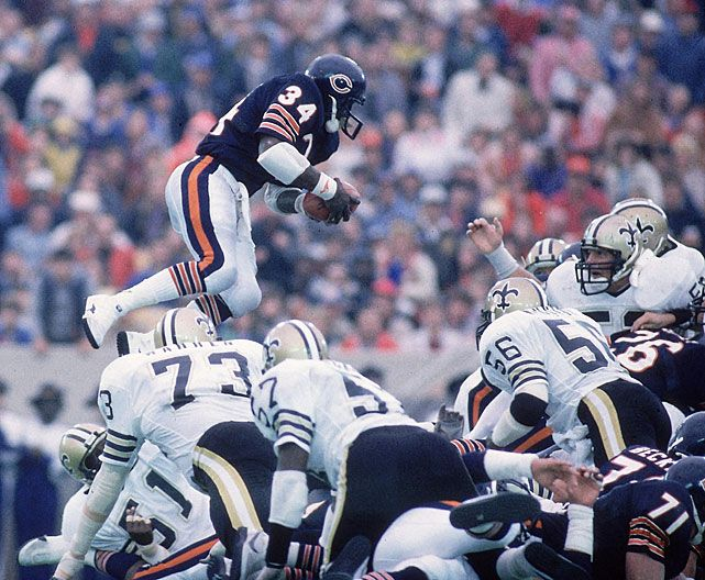 Walter Payton jumps over a pile of defenders to score a touchdown during a 1984 Bears-Saints game. Later in the game, Payton would pass Jim Brown as the NFL's all-time leading rusher. (Andy Hayt/SI)  GALLERY: Rare Photos of Walter Payton| NFL's All-Time Top RBs