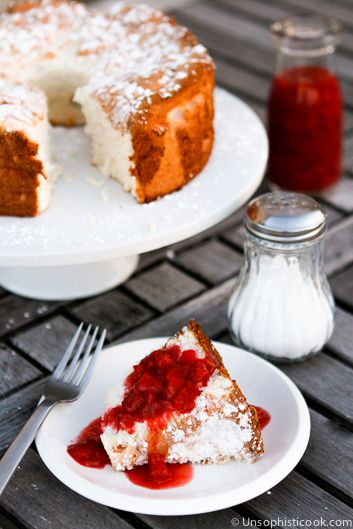 Angel Food Cake -- topped with homemade strawberry sauce, this angel food cake makes for an extra special any time dessert!