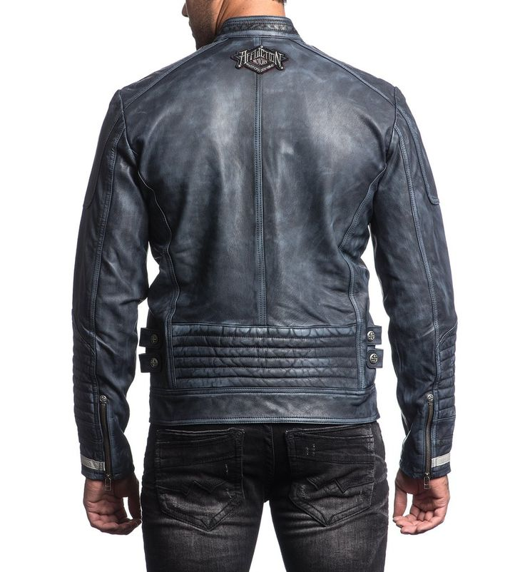 DETAILS • Affliction Leather Jacket • Perforated Detail at Sleeves Front Panels and Collar • Custom Print Inside Back Lining • Indigo Blue Wash CONTENT AND CARE • 100% Lamb Skin Leather • Machine Wash