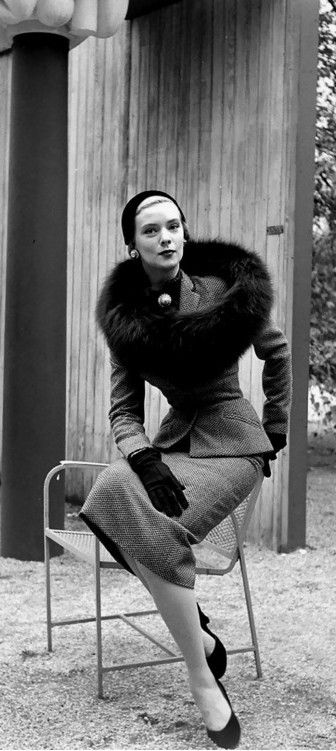 Barbara Wood in a tailored tweed town suit with black fox circle by Omar Kiam, photo Nina Leen 1950