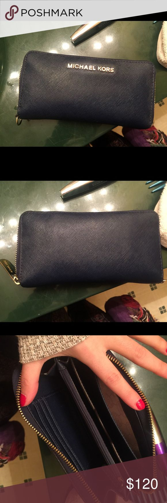 Jet Set Michael Kors wallet Navy blue, gently used Michael Kors jet set wallet - more pics at request Michael Kors Bags Wallets