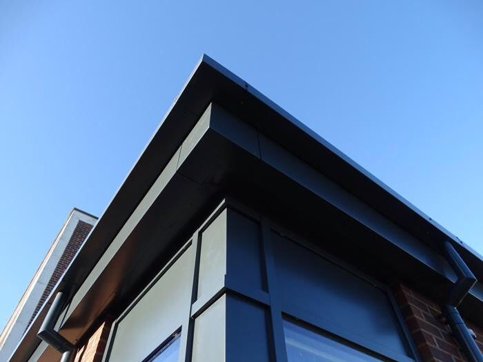 Aluminium fascia & soffits with matching box guttering and flushjoint downpipes www.guttercentre.co.uk