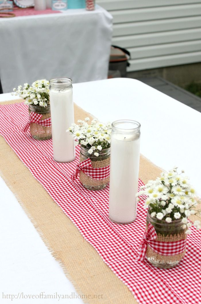 inexpensive jar candles from the dollar tree u0026 mason jars wrapped in burlap with red gingham bow simple u0026 easy table decor for themed party