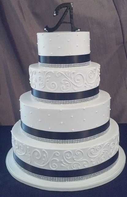 Black and white wedding cake. I like the different textures on the layers. I would want a color or pattern instead of black
