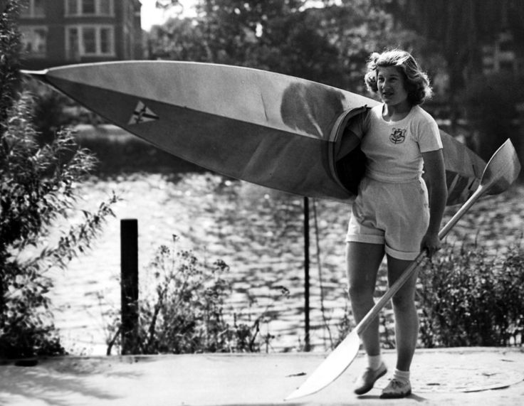 1949 British Olympic canoeist Joyce Webb taking her canoe out to train on the Thames.