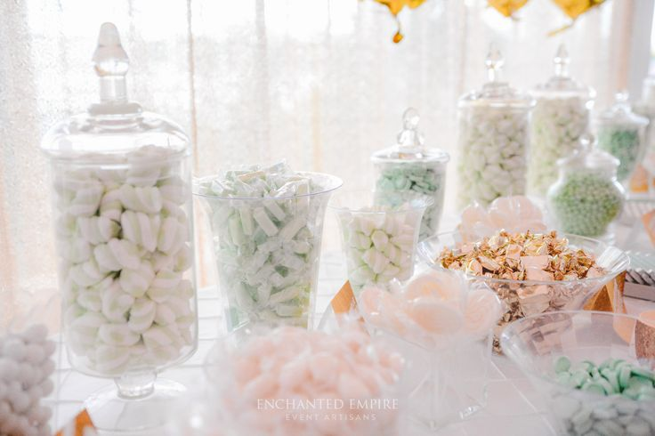 Set with a clean crisp white base, this luxurious candy bar palette was delicate and refined. With soft hues of mint, accented with gold highlights to draw this beautiful theme together. As all end of year celebrations, the gold megaloons were a great addition to the champagne sequin backdrop to frame this dessert station. Wedding reception. Event ideas. See the full video on our YouTube channel: https://youtu.be/Q3OmMUWFx7g