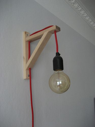 . Cool way to hang the mason jar lamp.  Paint the bracket to match the wall.