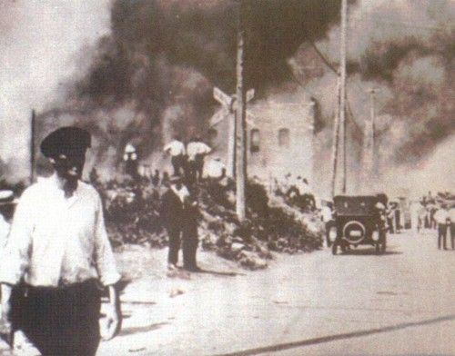 """Tulsa, Oklahoma, June 1, 1921.  The Greenwood District (""""the Negro Wall Street"""") and residential areas were burned to the ground by white supremacists. Over 800 people were admitted to local hospitals; an estimated 10,000 were left homeless, and 35 city blocks [1,256 homes] burned. The official count of the dead was 36, but estimates of Black fatalities have been up to about 300."""