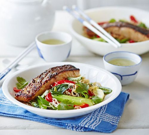 Crispy Asian salmon with stir-fried noodles, pak choi & sugar snap peas Don't use the rapeseed oil, but use the sesame oil 4 syns for 2tsp