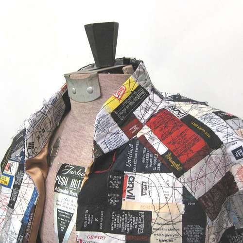 Upcycled Fashion Labels--quilted & fused to interfacing, then cut & sewn into a garment. $1,100.