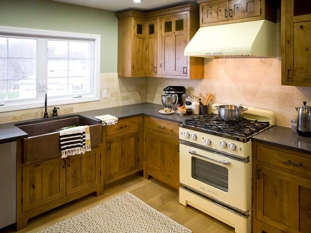 Kitchen Cousins: Chic and polished kitchen with a yellow oven!