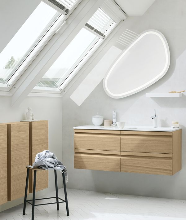 Dansani's organic and rounded Solo mirror with an LED frame is the ideal choice when looking for an elegant and functional solution beneath a sloping wall.