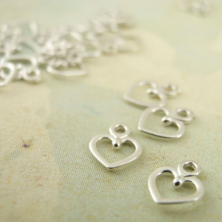 20 Petite Sterling Silver Heart Charms. $10.00, via Etsy.