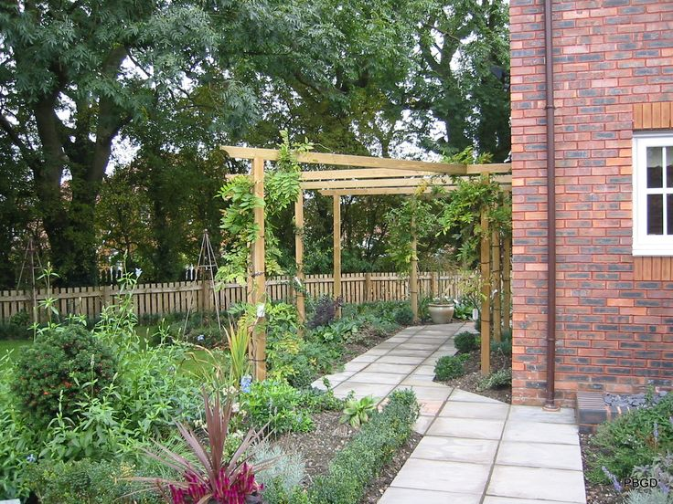 New pergola on blank side wall