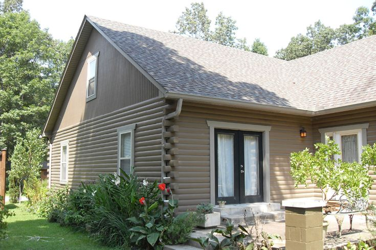 Faux painting log cabin exterior ironwood log home for Exterior finishes for homes