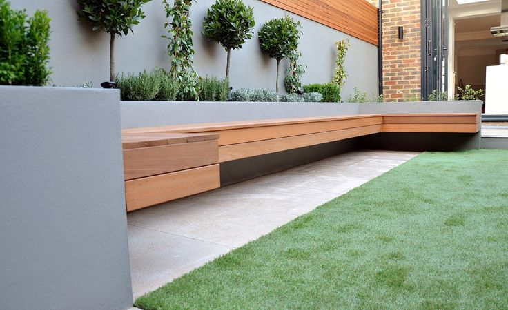 floating bench limestone cream light paving grey raised beds bay trees hardwood slatted privacy screen trellis clapham london