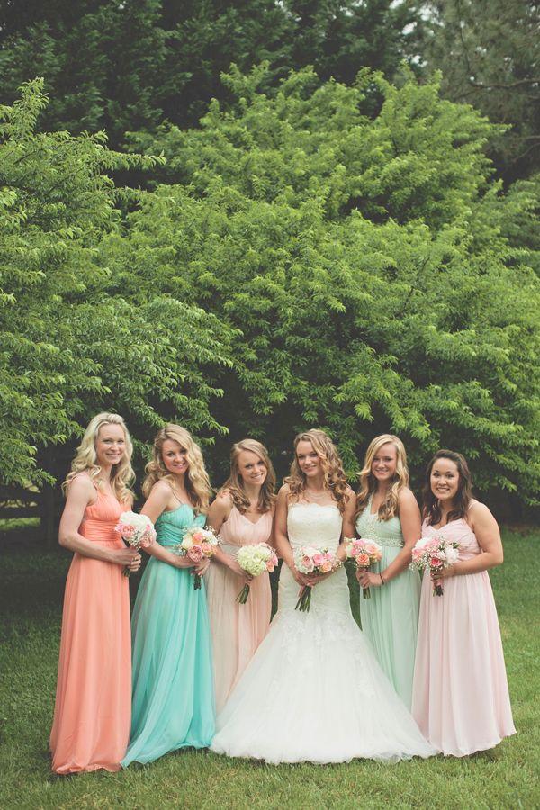 pastel bridemaid dresses http://www.weddingchicks.com/2013/10/17/tea-party-wedding/