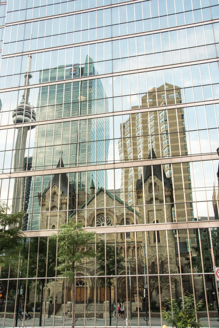 King st West, reflection of buildings Photo by Sophia