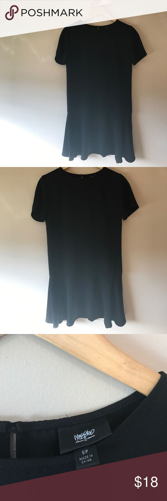 Mossimo Black Peplum Dress NWOT. Adorable Mossimo Black Peplum Dress. Could be worn with leggings or even jeans for a laid back chic look. Light weight material with tiny slit in the back towards neckline with pretty metal Button enclosure. Excellent condition-worn once to try on but in new condition. Measures approx 34.5 inches long fr top of shoulder. Mossimo Supply Co Dresses Midi