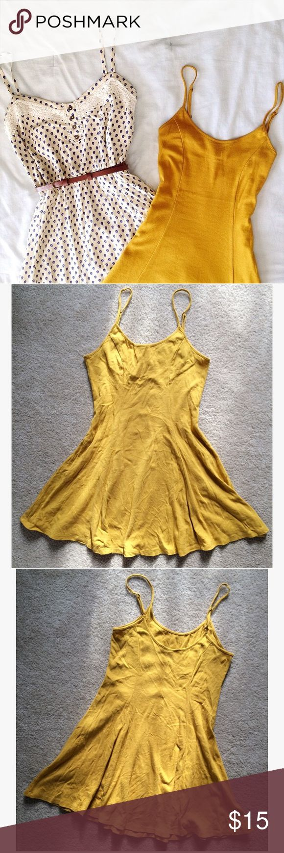 Golden Yellow Cami Dress Cute little cami dress in a golden yellow shade that is so in for spring and summer! Worn once, for an hour, this dress is in nearly new condition! Adjustable spaghetti straps allow you to customize the fit. Princess seams accentuate your curves. Forever 21 Dresses Mini