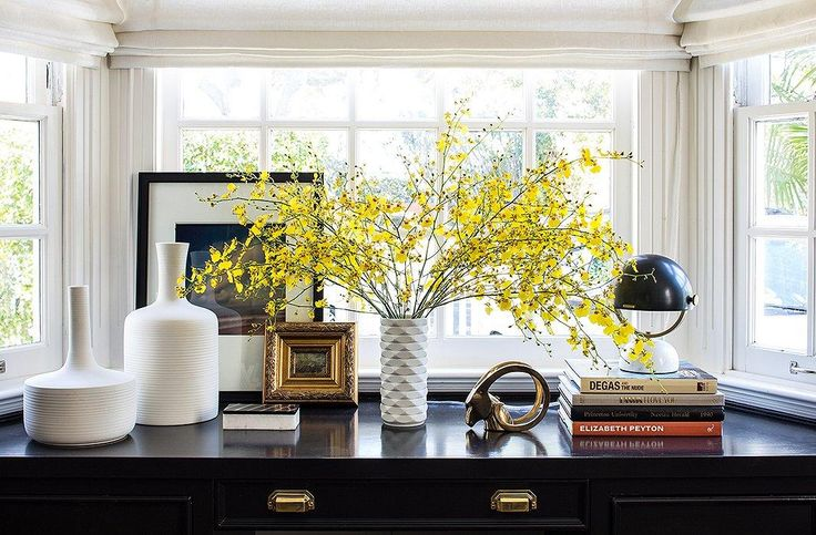 "Breath new life into an old desk by painting it a glossy black and topping with bold and modern accessories like a cluster of white ceramic vases, a domed midcentury desk lamp, and a tiny oil painting framed in antique gold for a hint of glam. See the full home office before and after makeover on IInside Our Superstylish Office Makeover for Le Catch's Fashion Editor Founder, Marlien Rentmeester"" on the One Kings Lane Style Guide!"