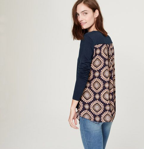 A clever approach to a cool layered look, we love the sweater-meets-blouse effect of this brilliantly graphic style. Round neck. Long sleeves. Knit front and sleeves. Woven front hem and back. Box pleat beneath back yoke.