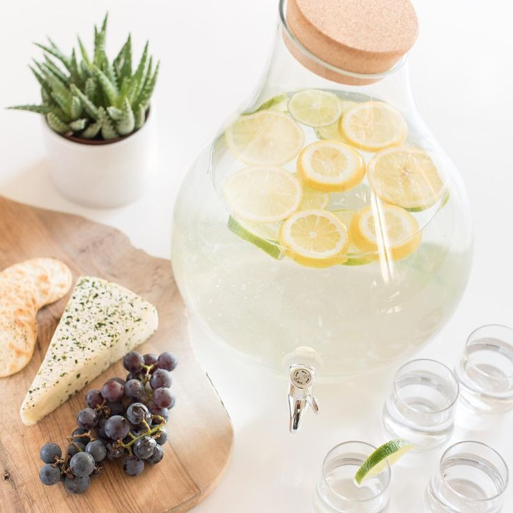 A curvaceous blown-glass beverage dispenser is an elegant way to display and serve your signature sangria or summer punch. #beverages #dispenser