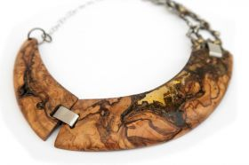 Ice Wood necklace Necklace made of secular olive briar with empty space filled by transparent bi-component resins and colored pigments.