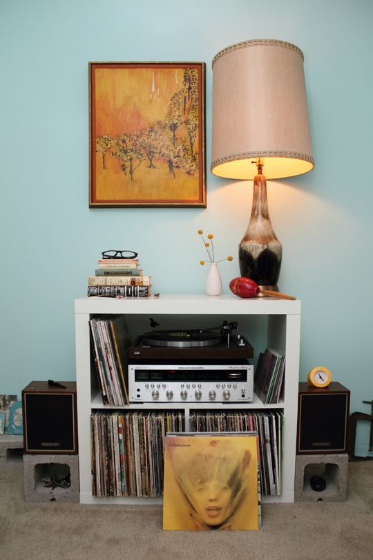 One of the rooms in Sophie & Isaac Carpenter apartment in Los Angeles, Valley Village. A simple room with record collection, speakers, turntable and hollow bricks as speaker stands.