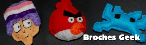 Descubre nuestros broches de fieltro y llaveros geek de Enjuto Mojamuto, Angry Birds, Space Invaders, Android, Twitter, Cut the Rope, IT Crowd y Gimp.