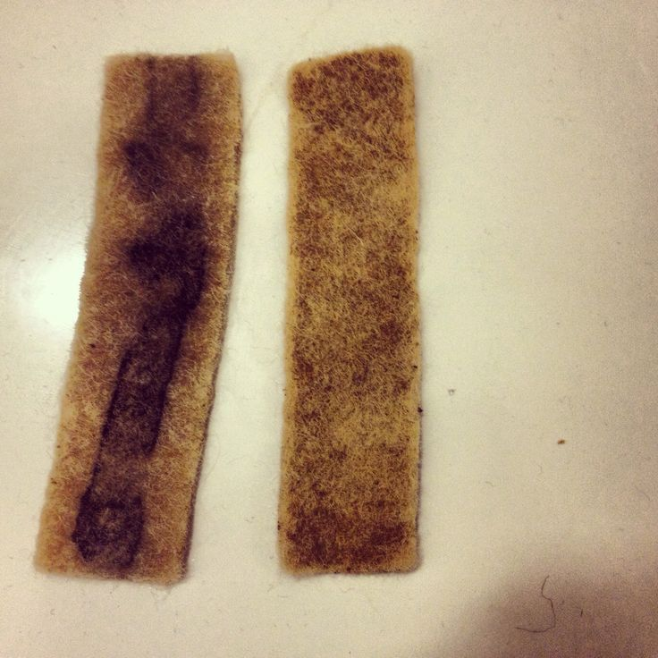 Wool felt dyed with acorn and scrap metal