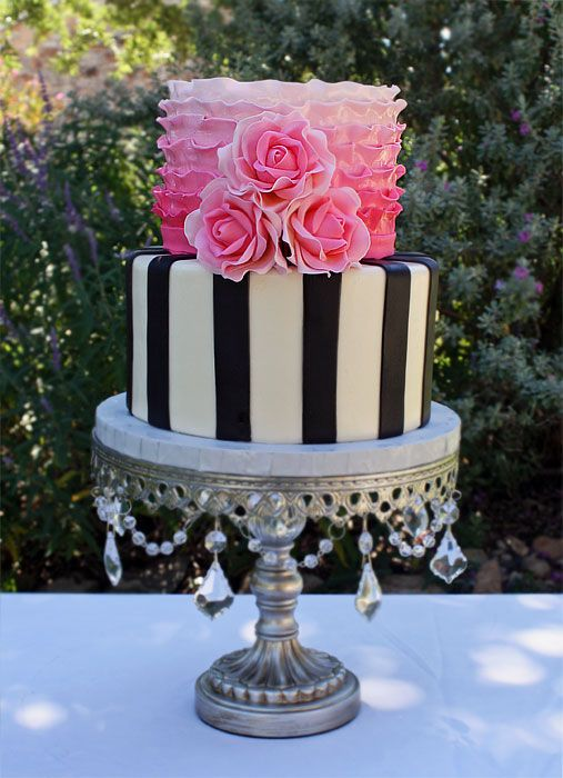 Black and white stripes, pink ombre ruffles, and pink roses