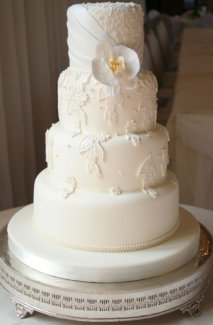 This classic lace inspired wedding cake was given a contemporary twist with the use of orchids. Stunning.