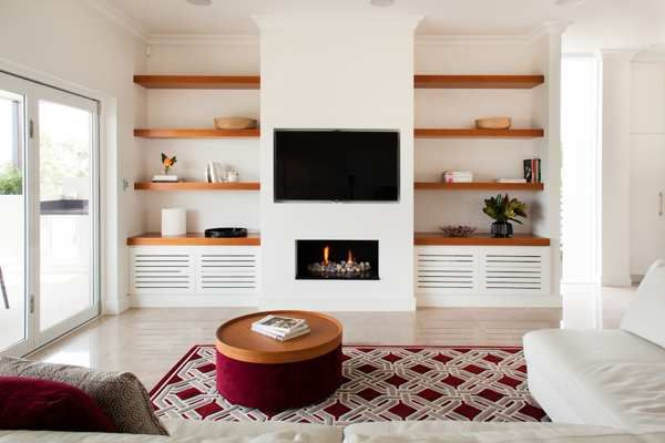 thick wood shelves and fireplace/tv combo