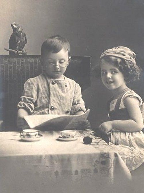 """Use old vintage children's photos for """"props""""   (really neat if  found some of  realtives)"""