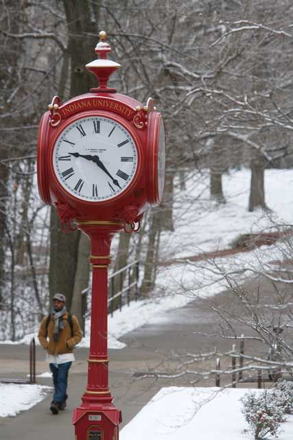 Snow, trees, red clock ... different winter to over here at beach cottage :p